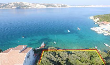 STARA NOVALJA Zemljište 552 m2 s idejnim projektom i vlastitom plažom,  PRVI RED DO MORA ► 280 €/m2